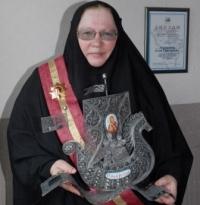 Член монахиня